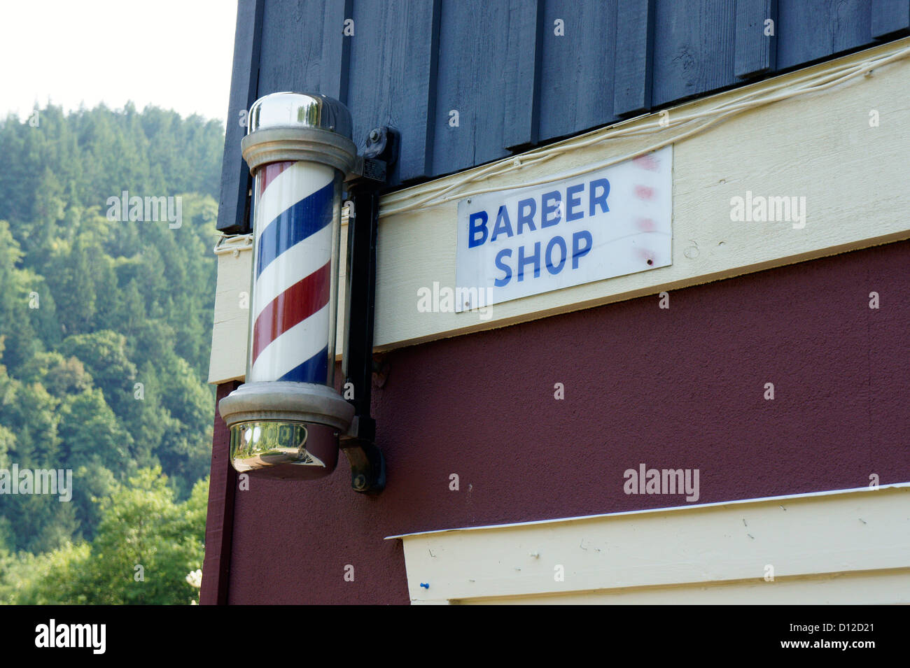 Barber shop pole and sign in Snug Cove, Bowen Island, British Columbia, Canada - Stock Image