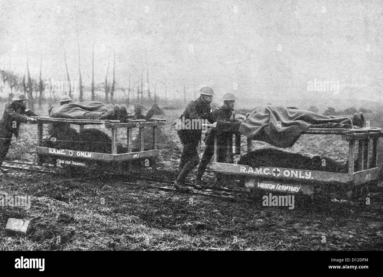 Ambulances being pushed long train tracks during World War I - Stock Image