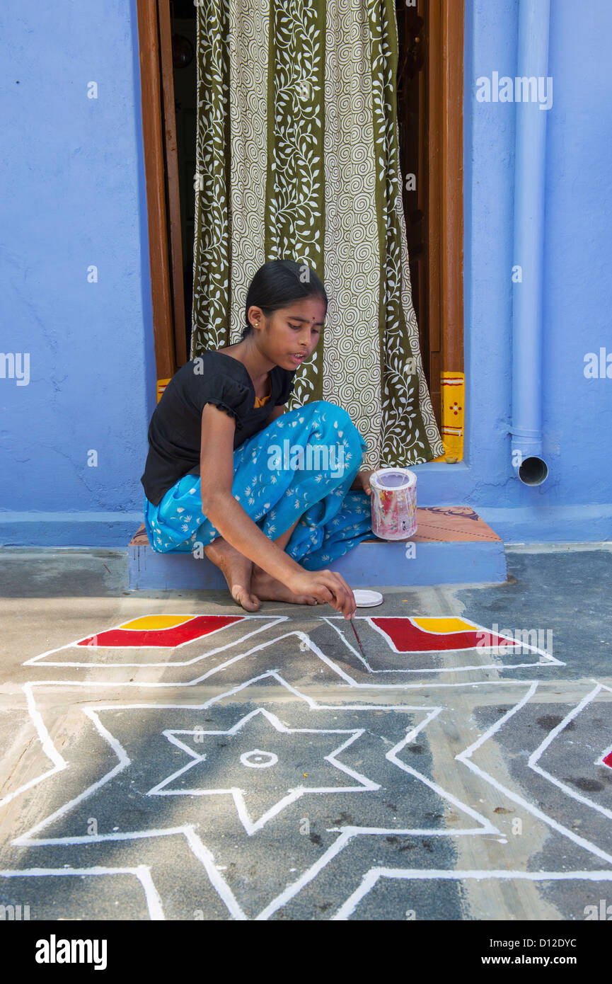 Teenage Indian Village Girl Painting Out A Rangoli Design