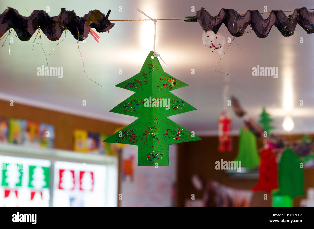 Indoor Decorations Of Xmas   Cut Out Of Red And Green Paper Christmas Tree  And Christmas Bells At Home During Xmas Holiday.