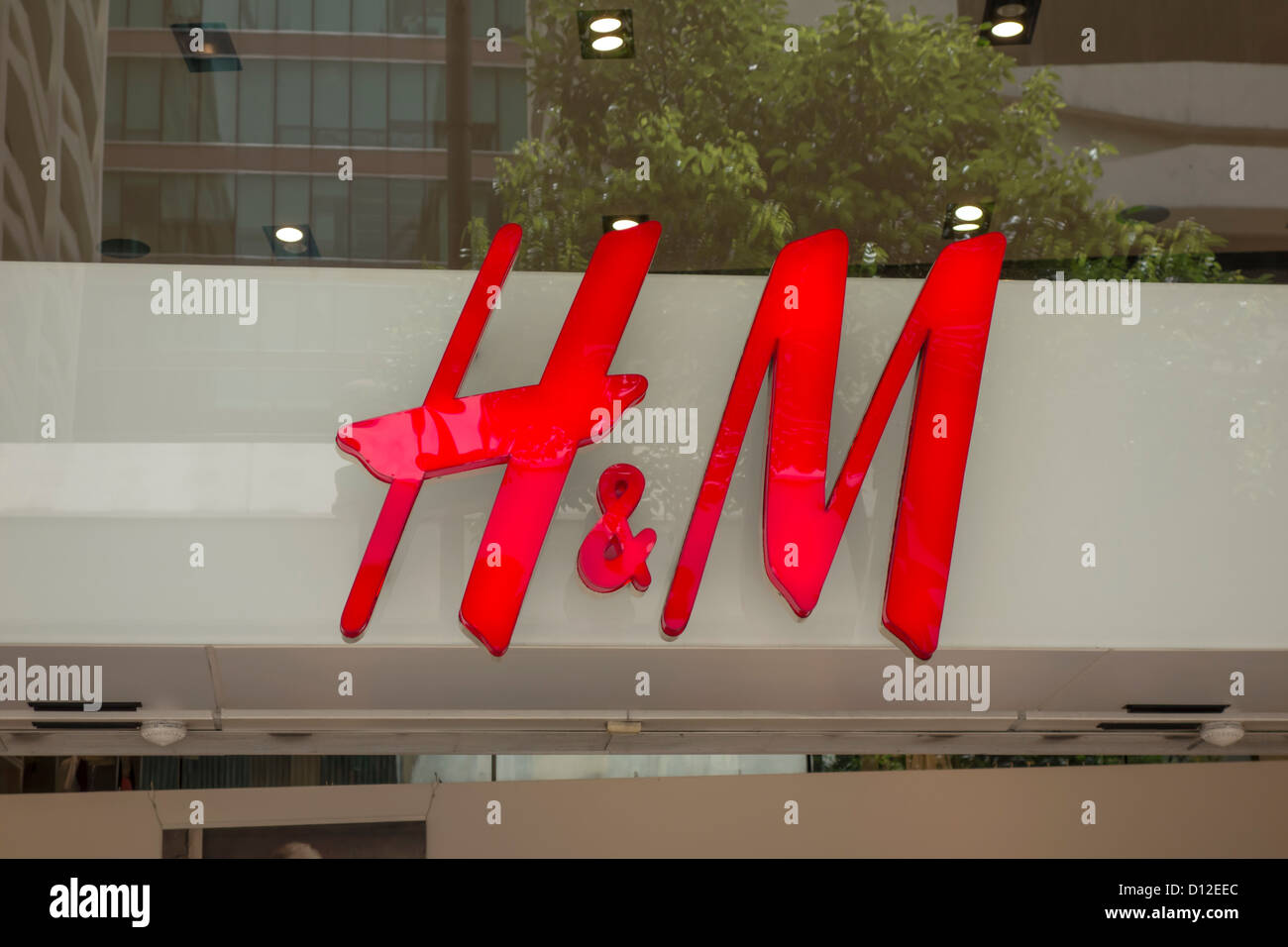 H&M shop logo closeup on the wall - Stock Image