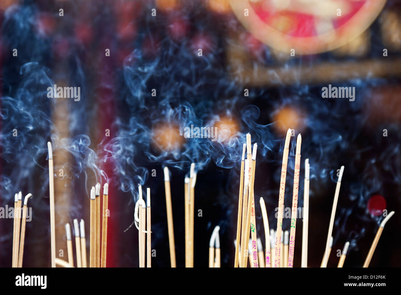 Incense left burning by worshipers at Wong Tai Sin Temple. Also known as Sik Sik Yuen Wong Tai Sin Temple in Hong - Stock Image