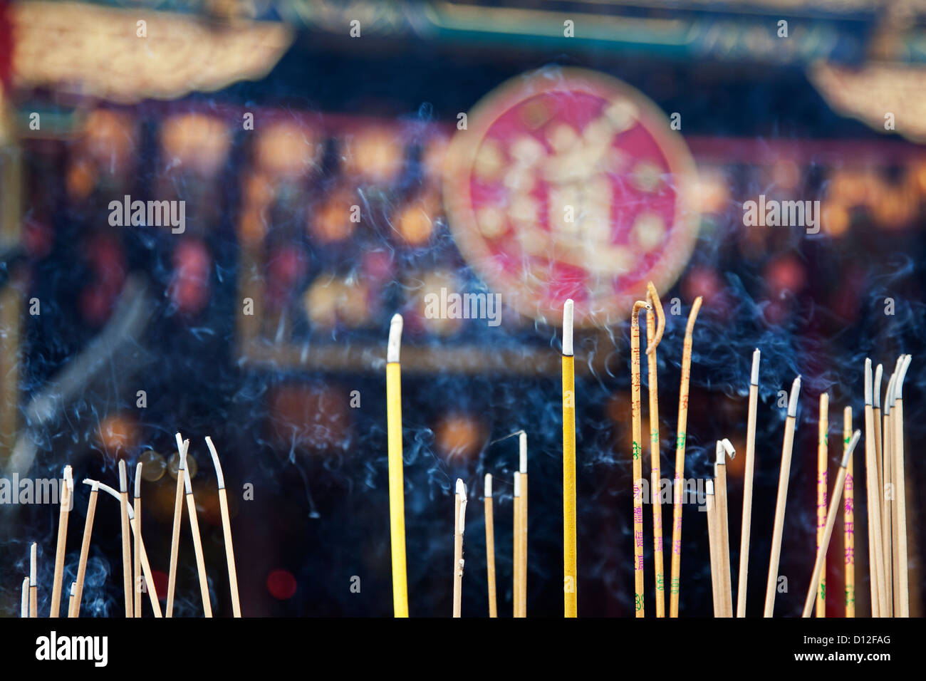 Incense left burning by worshipers at Wong Tai Sin Temple. Also known as Sik Sik Yuen Wong Tai Sin Temple - Stock Image