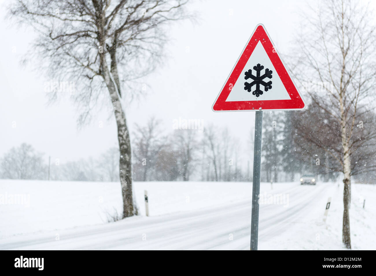 Road sign beside wintry road in Bavaria/Germany - Stock Image