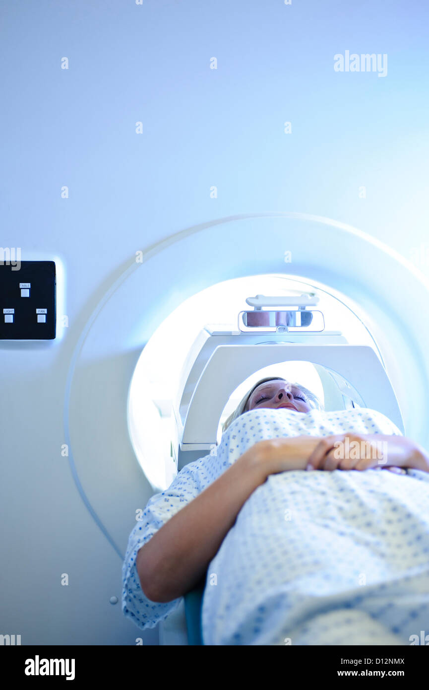 Young female hospital patient in MRI scanner Stock Photo
