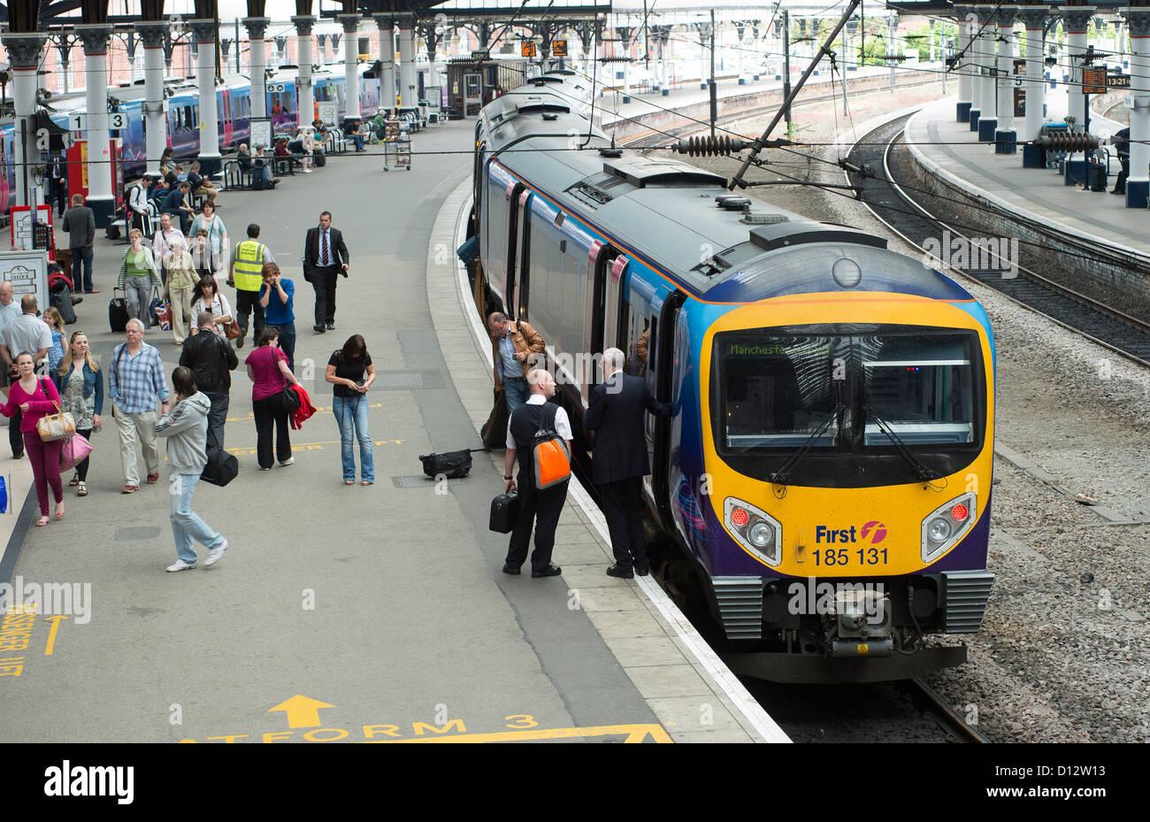 First Transpennine Express Class 185 passenger train waiting at a platform at York Railway Station, England. - Stock Image