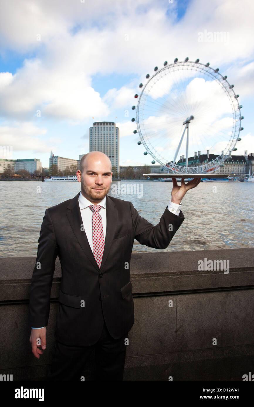 Tourism & Hospitality Management Graduate, London, UK - Stock Image