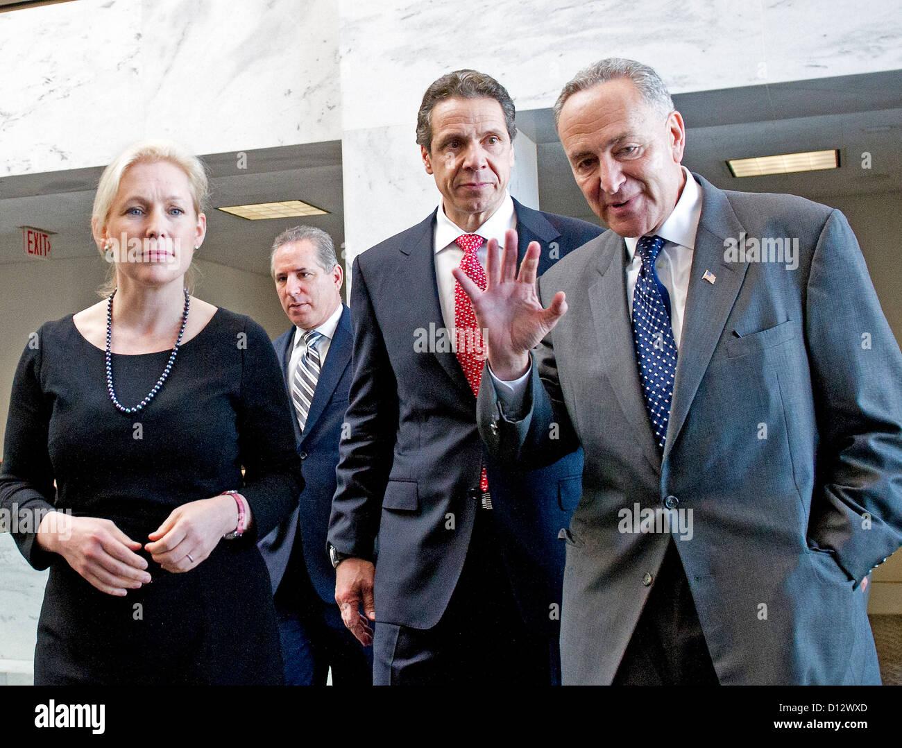Governor Andrew Cuomo (Democrat of New York), center, walks with United States Senators Kirsten Gillibrand (Democrat - Stock Image