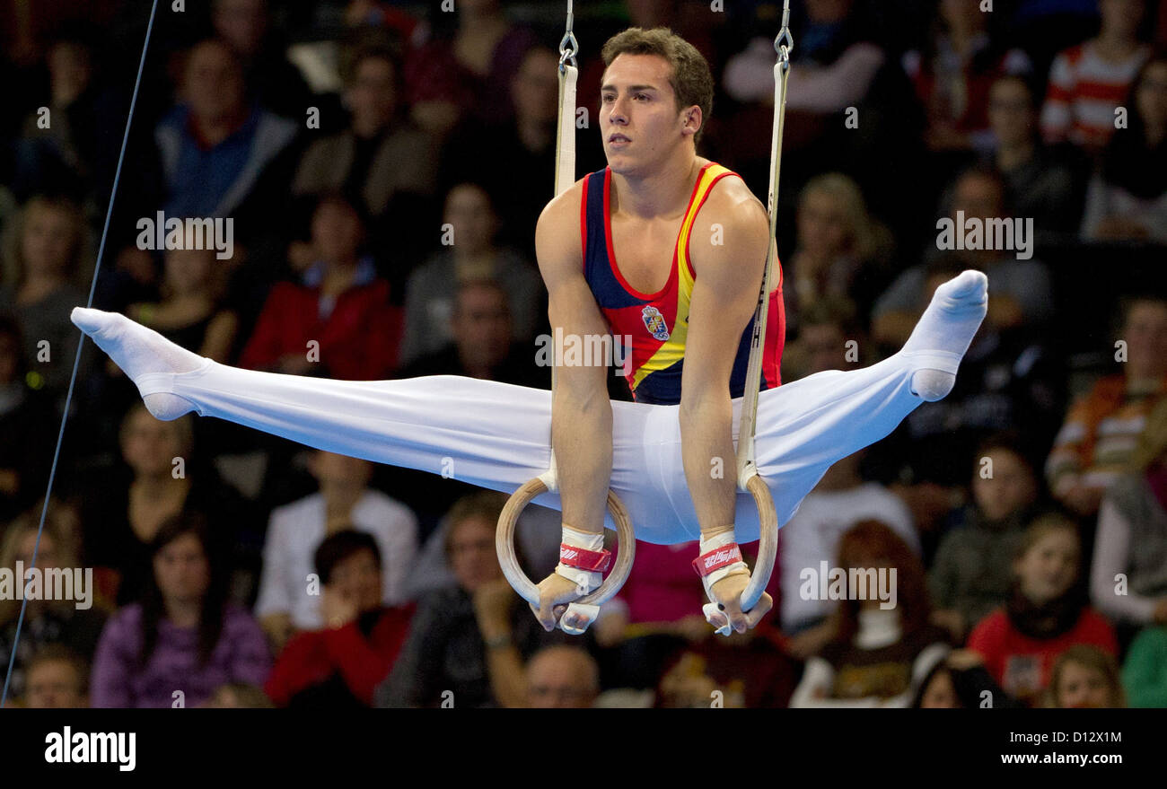 Fabian Gonzales from Spain competes on the rings during the athletics world cup in Stuttgart, Germany, 2 December - Stock Image