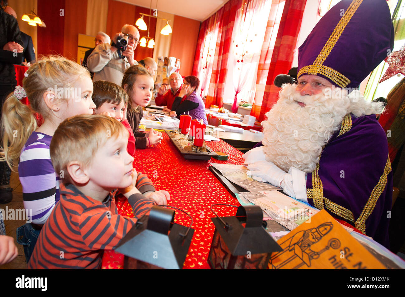 Saint Nicholas talks to children from a kindergarten who brough thim their letters at Saint Nicholas' post office Stock Photo