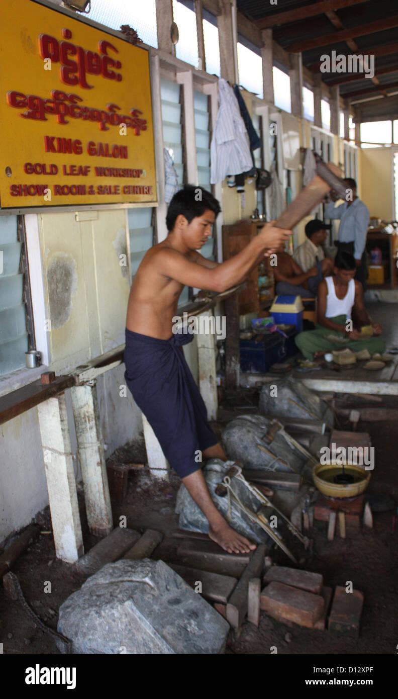 Employees work at the sheet gold factory King Galon (Myetparyat Township) in Mandalay, Myanmar, 25 October 2012. - Stock Image