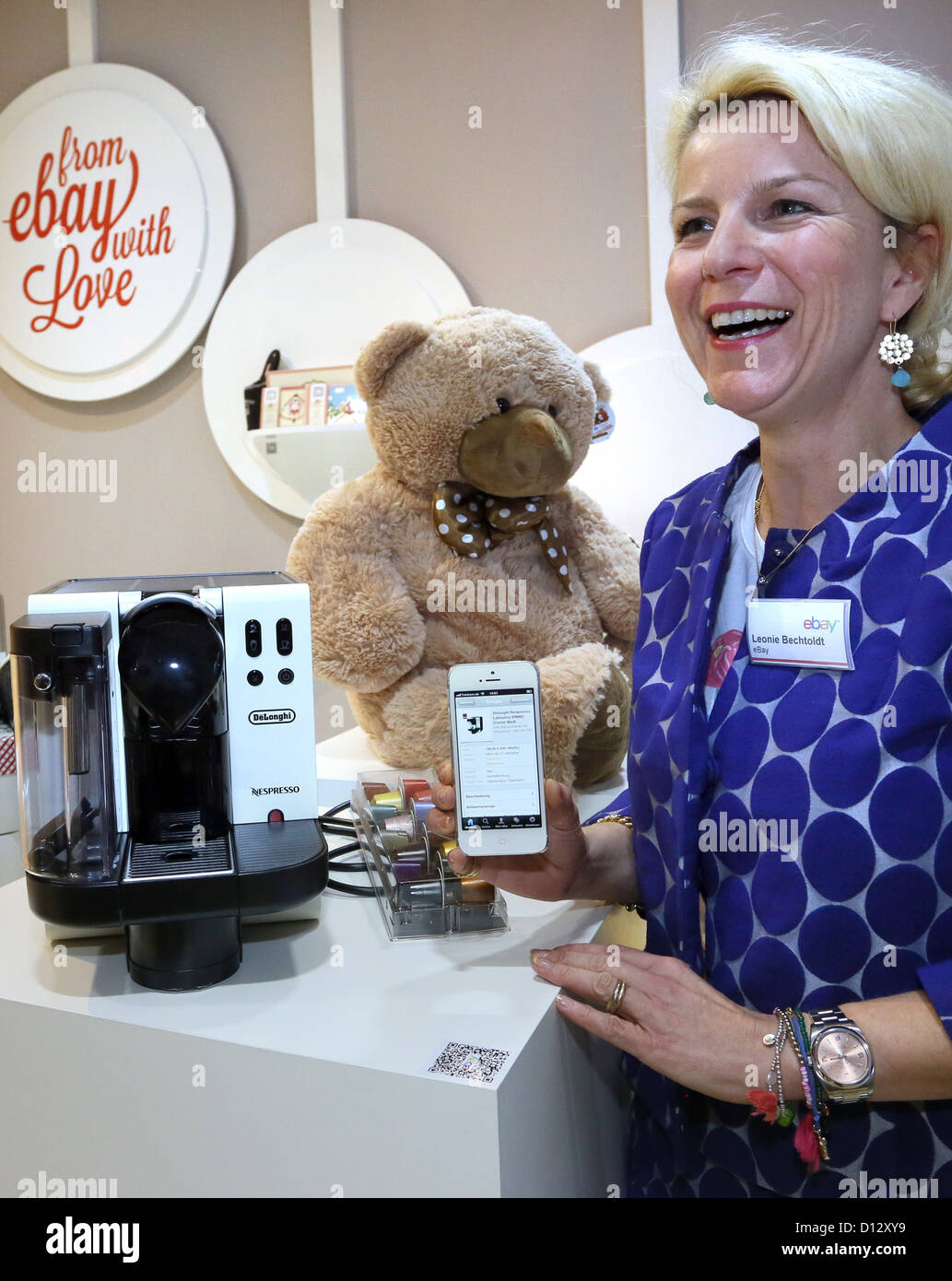 Leonie Bechthold of ebay presents a scanned code for a coffee machine at the new ebay Purchasing Shop (ebay-Kaufraum) - Stock Image