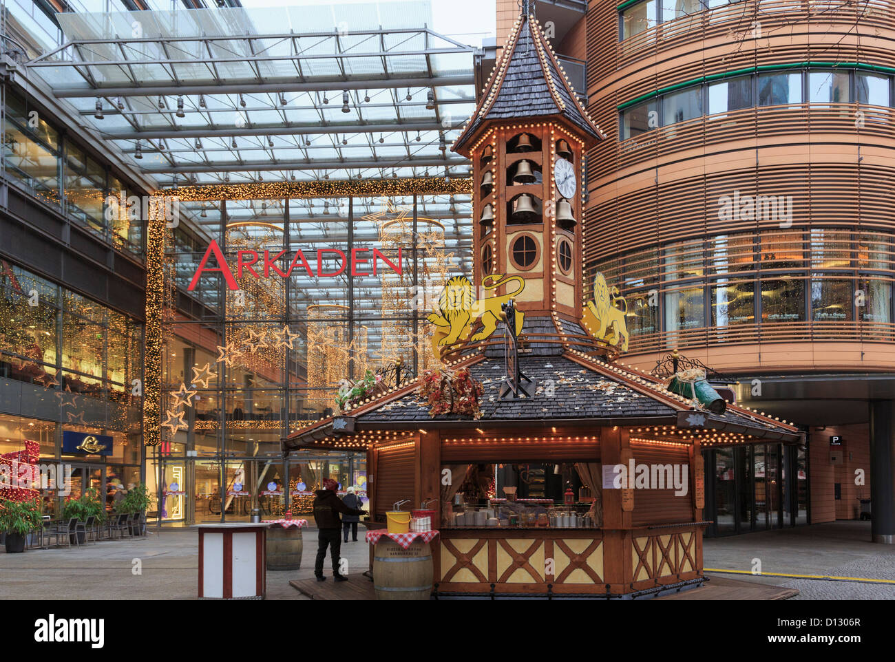 Christmas market stall by the entrance to Arkaden shopping centre mall at Potsdamer Platz, Berlin, Germany - Stock Image
