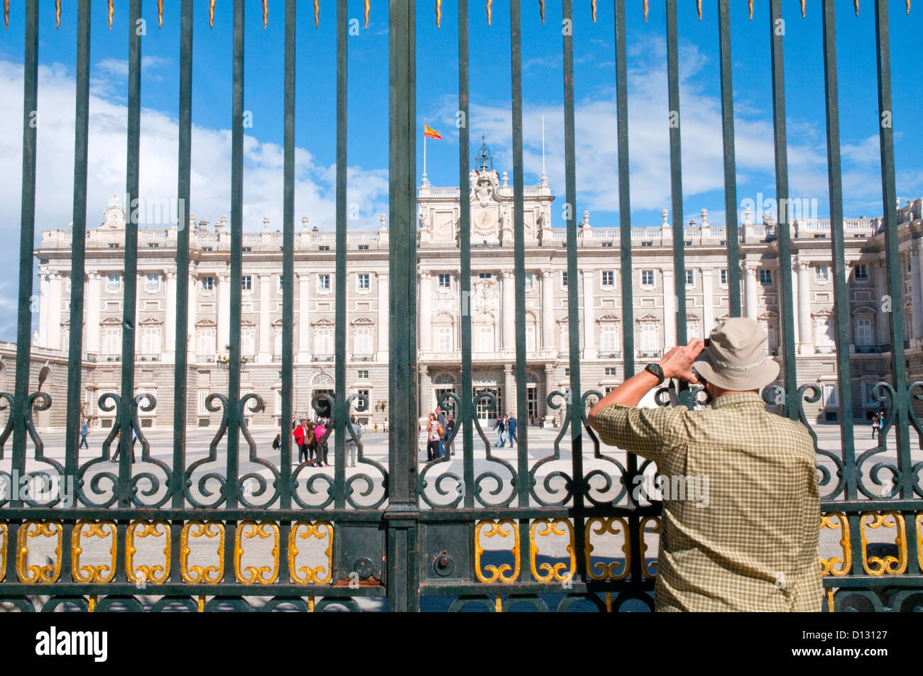 Man taking photos of the Royal Palace. Armeria Square, Madrid, Spain. - Stock Image