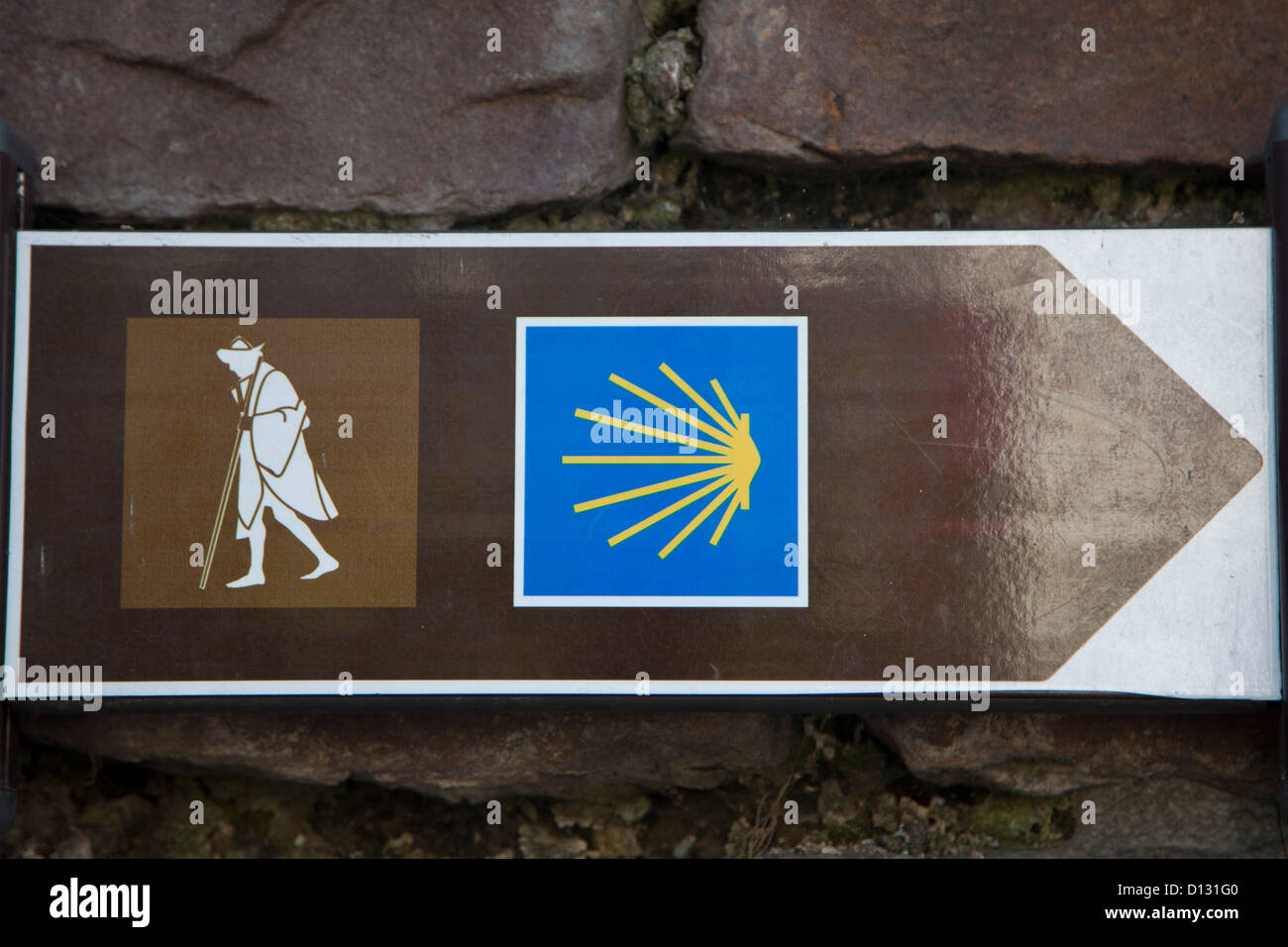 Pilgrim sign and yellow scallop shell marking the way for the pilgrim to Santiago. The Way of St. James, the French - Stock Image