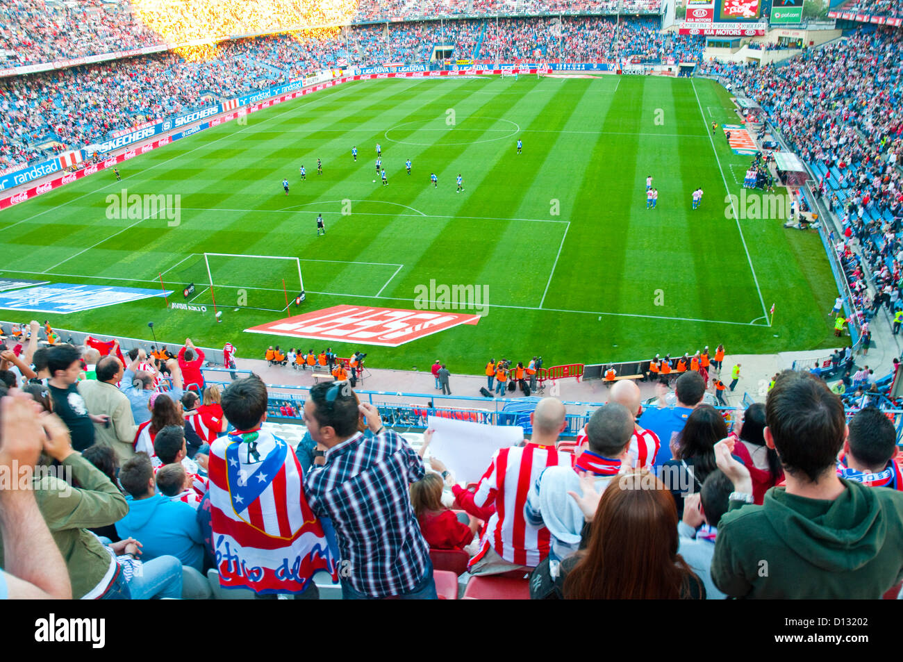 People in Vicente Calderon stadium, during a football match. Madrid, Spain. - Stock Image