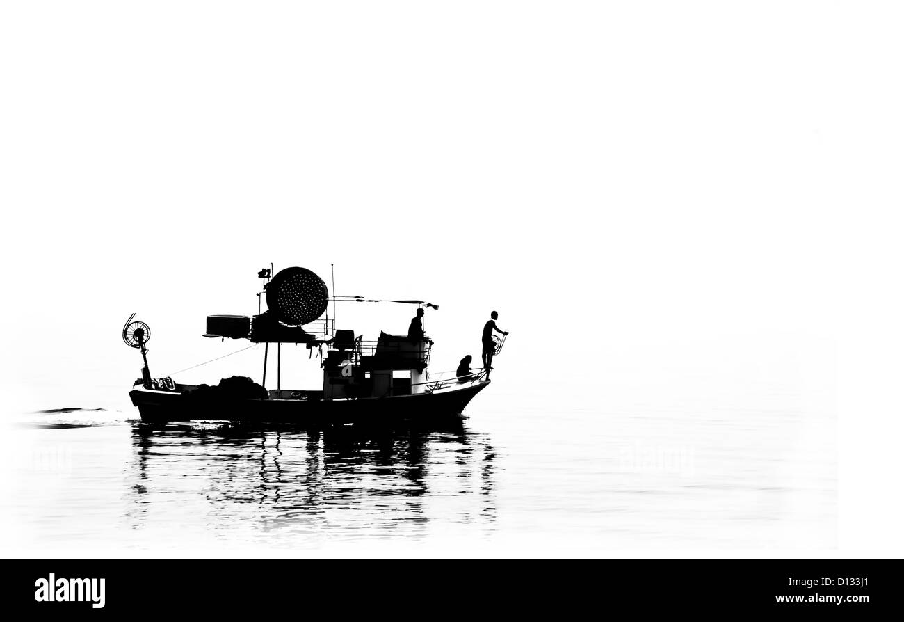 B&W Silhouette of a fisher boat at open sea. - Stock Image