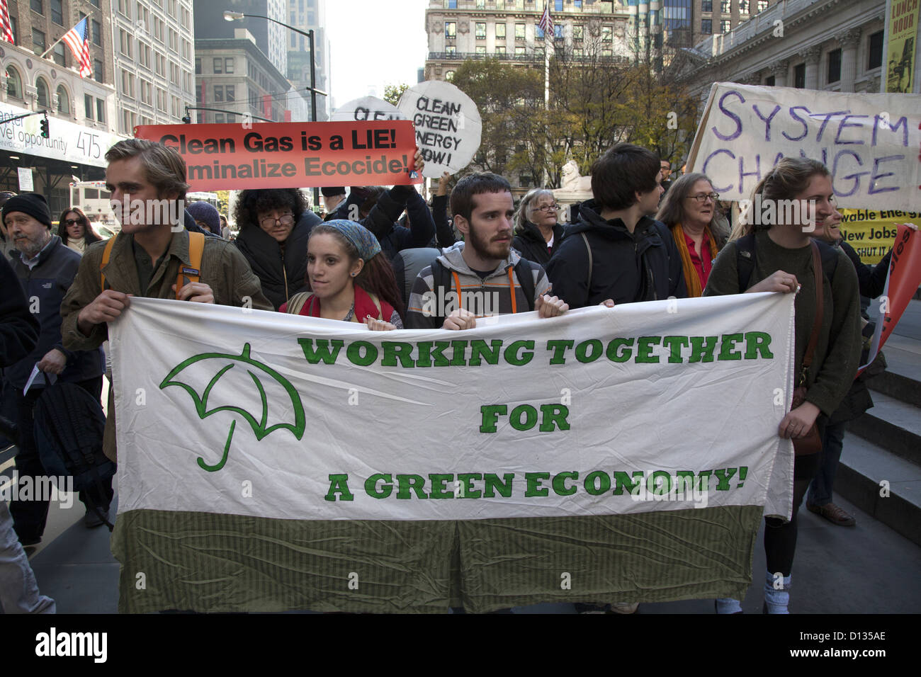 Environmentalists were on streets in midtown recently to keep the pressure on big corporations to be good environmental - Stock Image