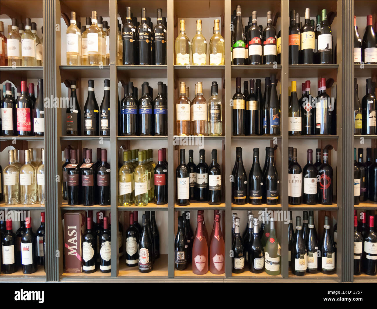 A Wall In An Italian Restaurant Covered With Display Shelves
