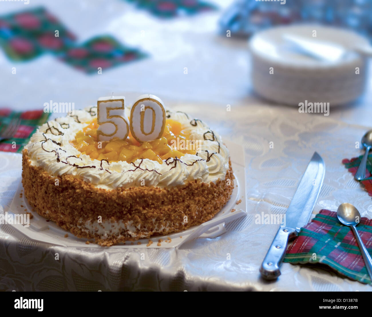 50th Birthday Cake On Table In Poor Family