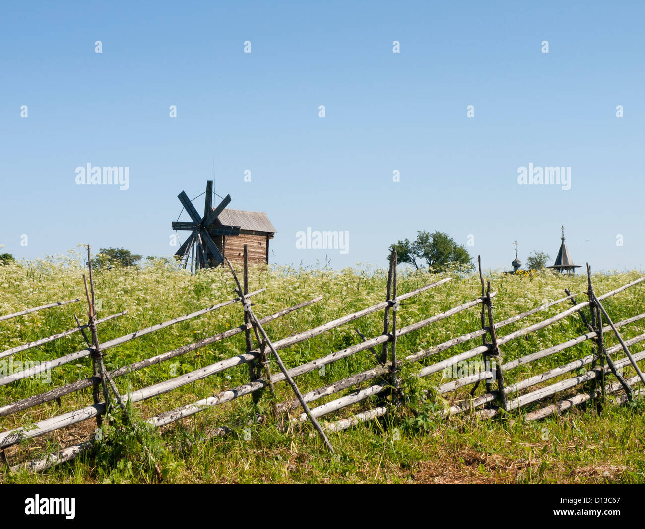 Kizhi open air museum on the island in Onega lake in Russia roundpole fence fields and wooden windmill - Stock Image