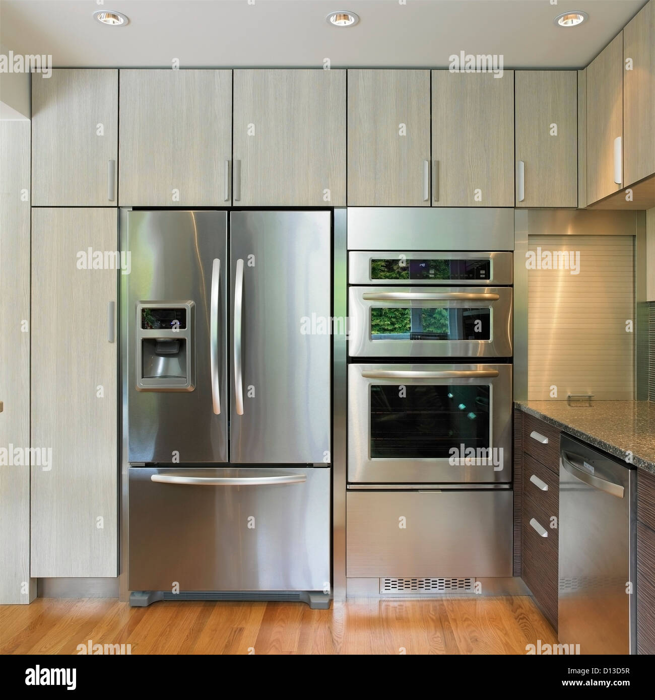 Kitchen wall featuring built in fridge and wall oven victoria vancouver island british columbia canada