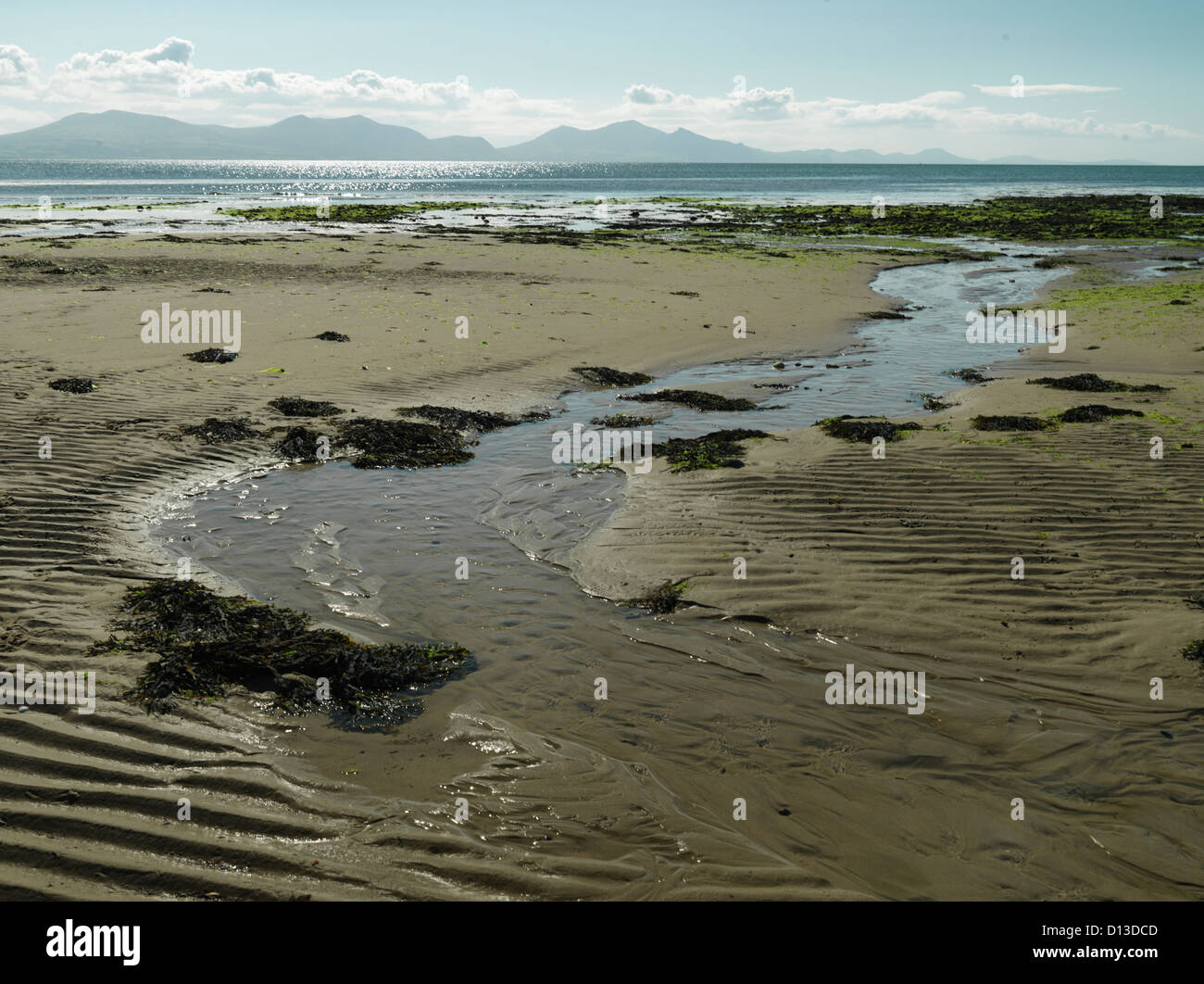 Tide out on Isle of Anglesey beach - Stock Image