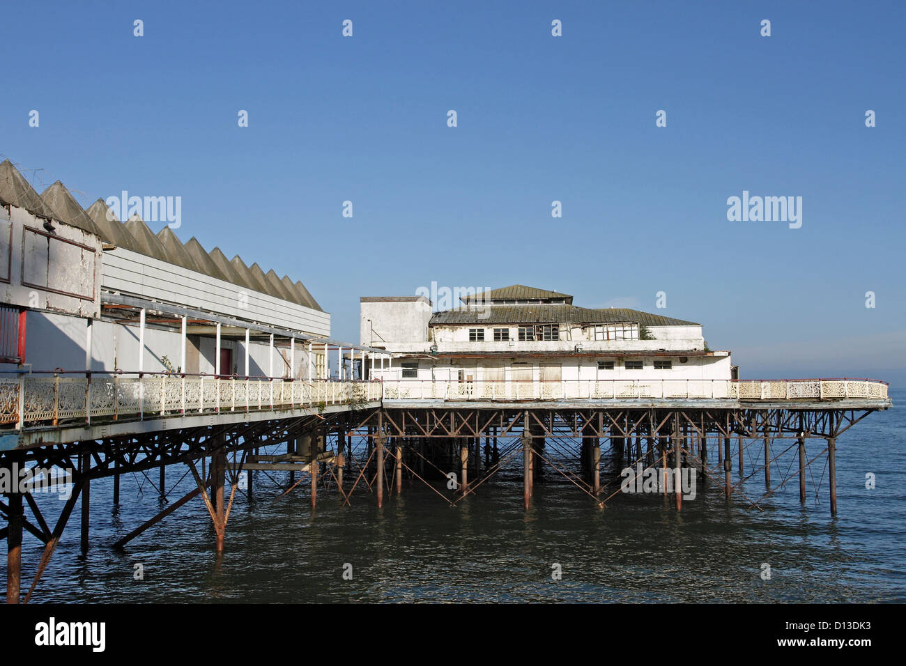 The old dilapidated Victorian Pier in Colwyn Bay, North Wales. - Stock Image