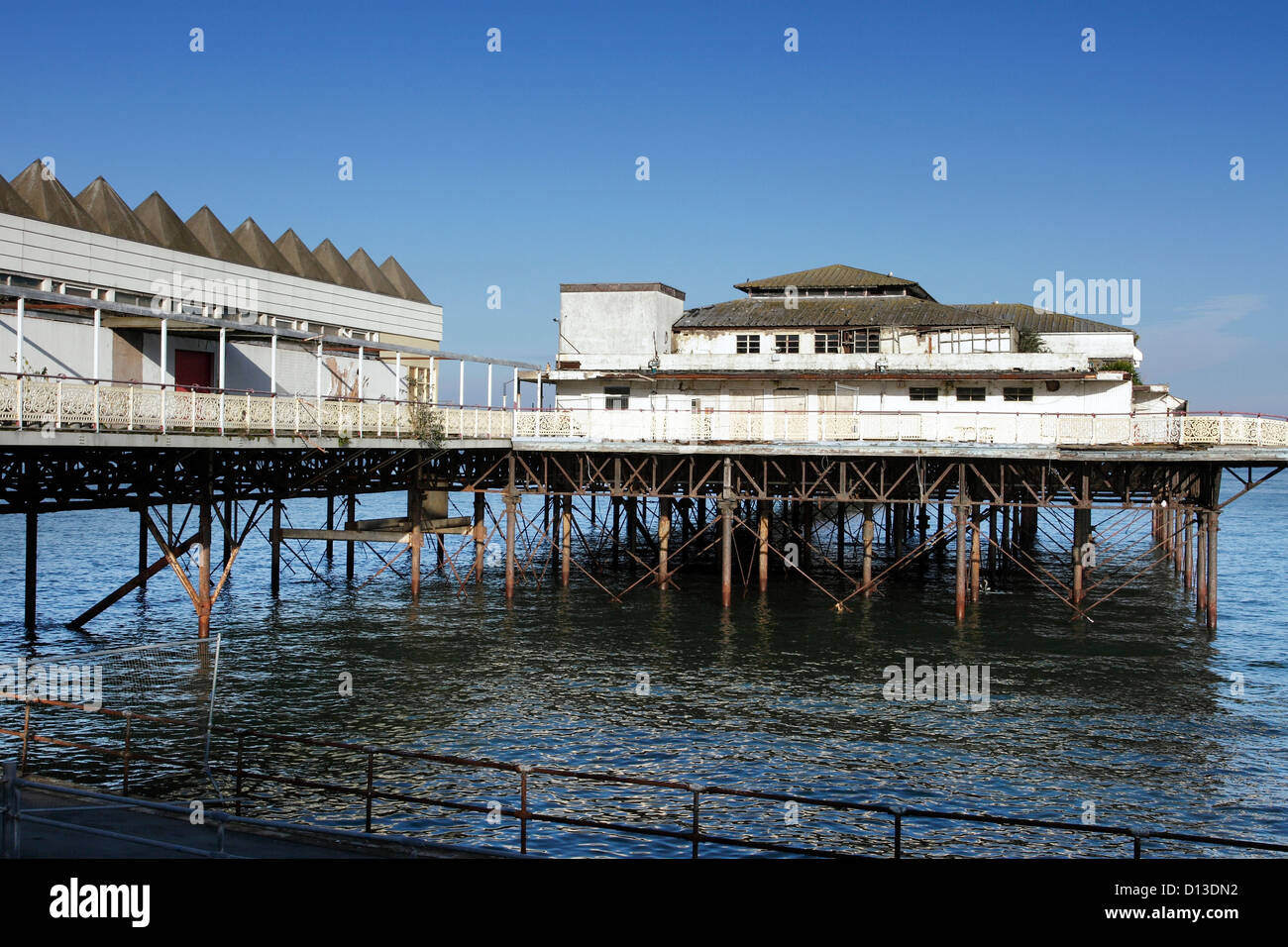 The old dilapidated Victoran Pier in Colwyn Bay, North Wales. - Stock Image