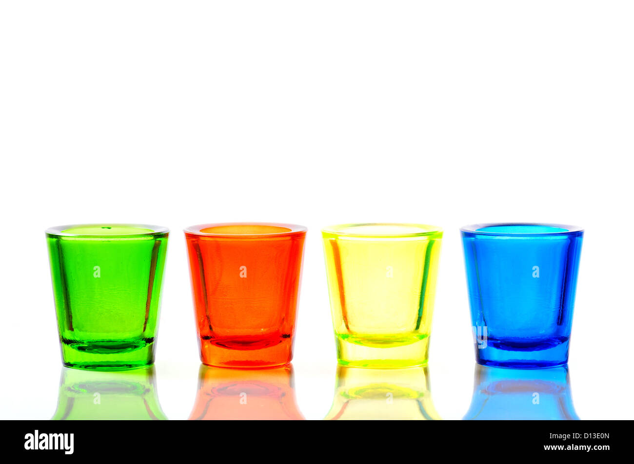 four color blue, yellow, red and green glass candlestick - Stock Image