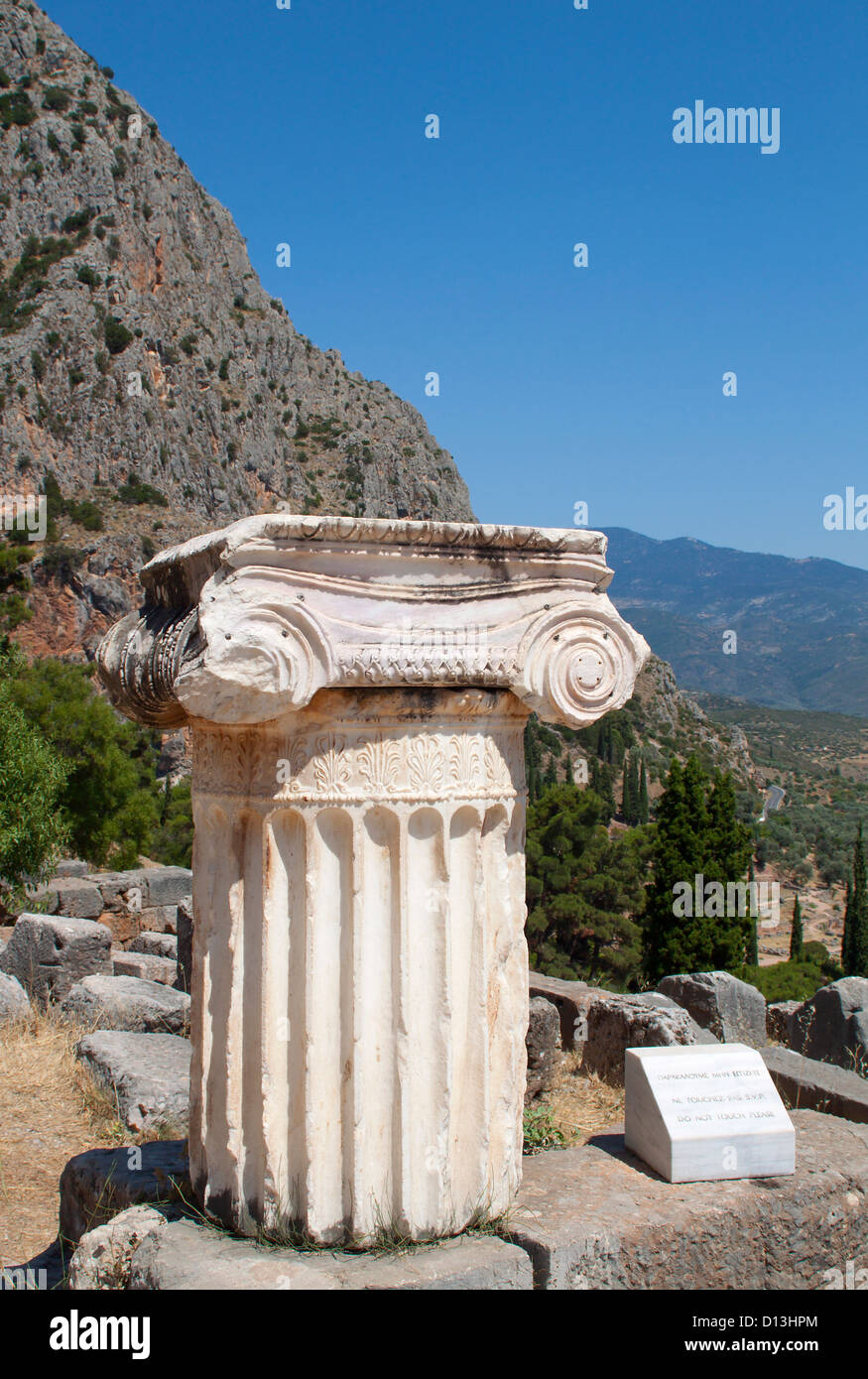 Single ionic order capital at Delphi archaeological site in Greece Stock Photo