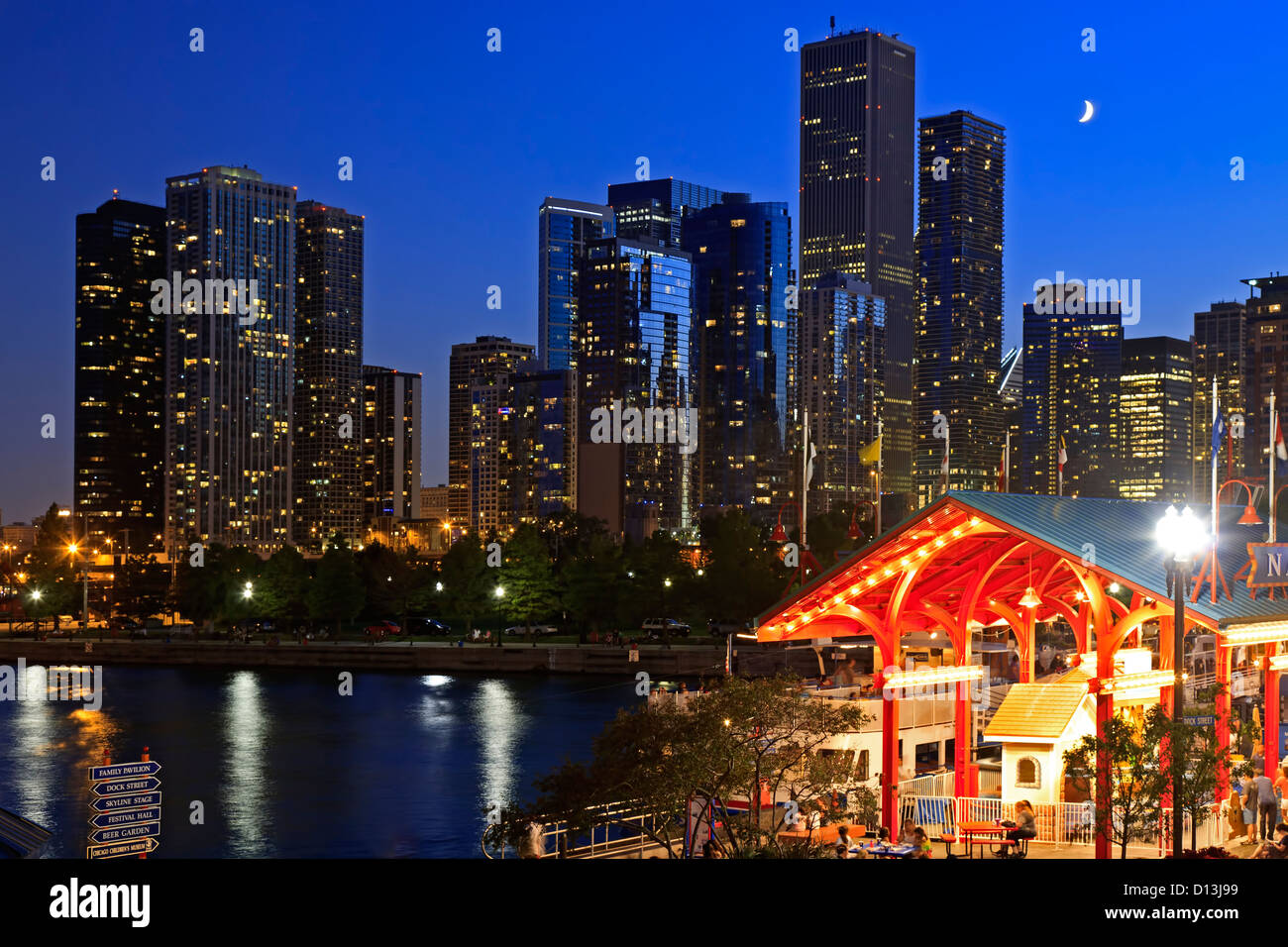 Quarter moon over skyline from Navy Pier, Chicago, Illinois USA - Stock Image
