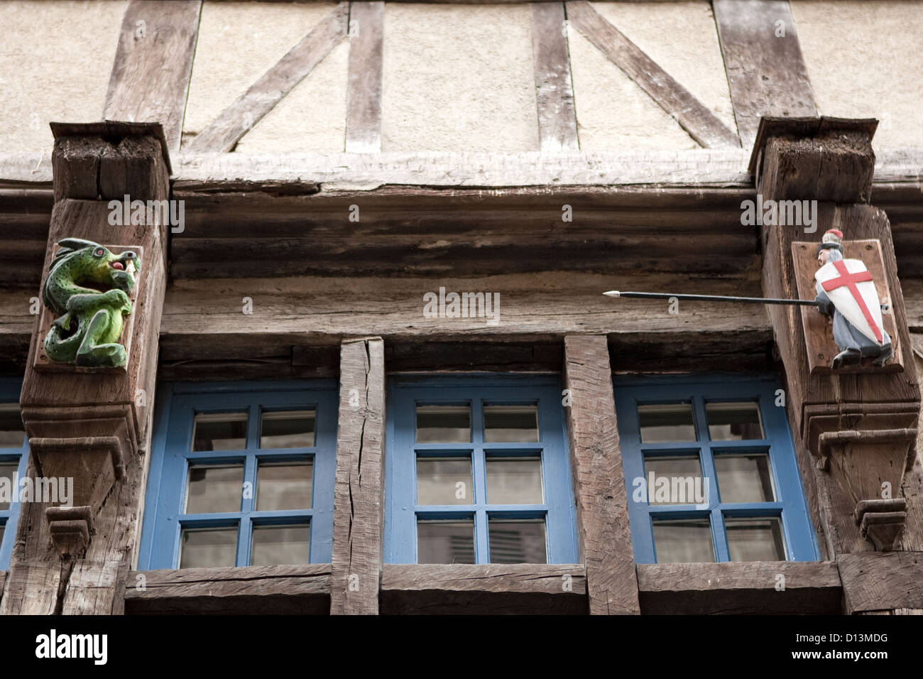 George & Dragon motifs Dinan Brittany France - Stock Image