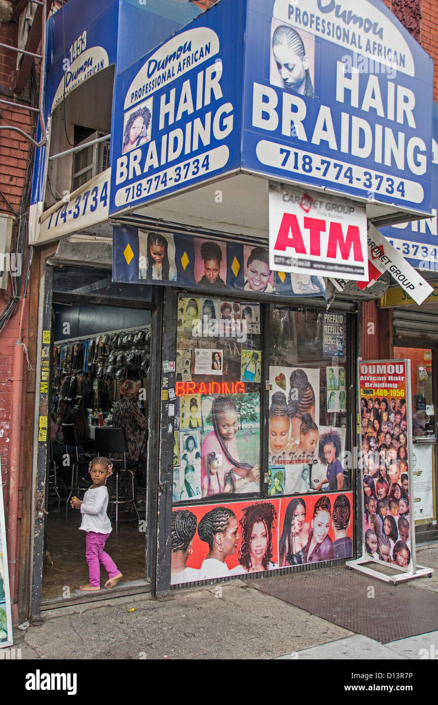 Little girl with Rasta hairs in front of Braiding Shop, Crown Heights , Brooklyn, New York - Stock Image