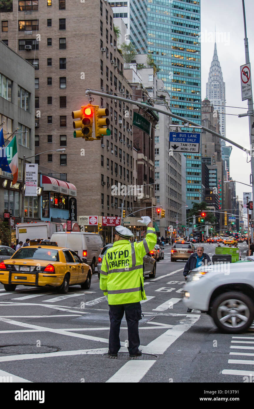 NYPD Traffic policemen at 57 th street, backgrounbd Chrysler building, New York City - Stock Image