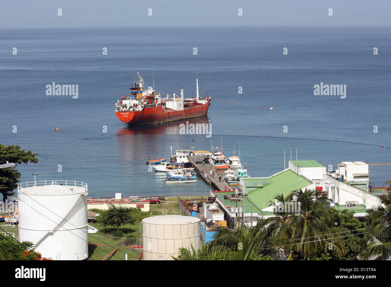 Grenada. View of fuel tanker offshore from storage tanks. - Stock Image