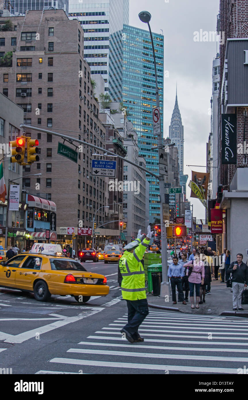 NYPD Traffic policemen at 57 th street, background Chrysler building, New york City - Stock Image