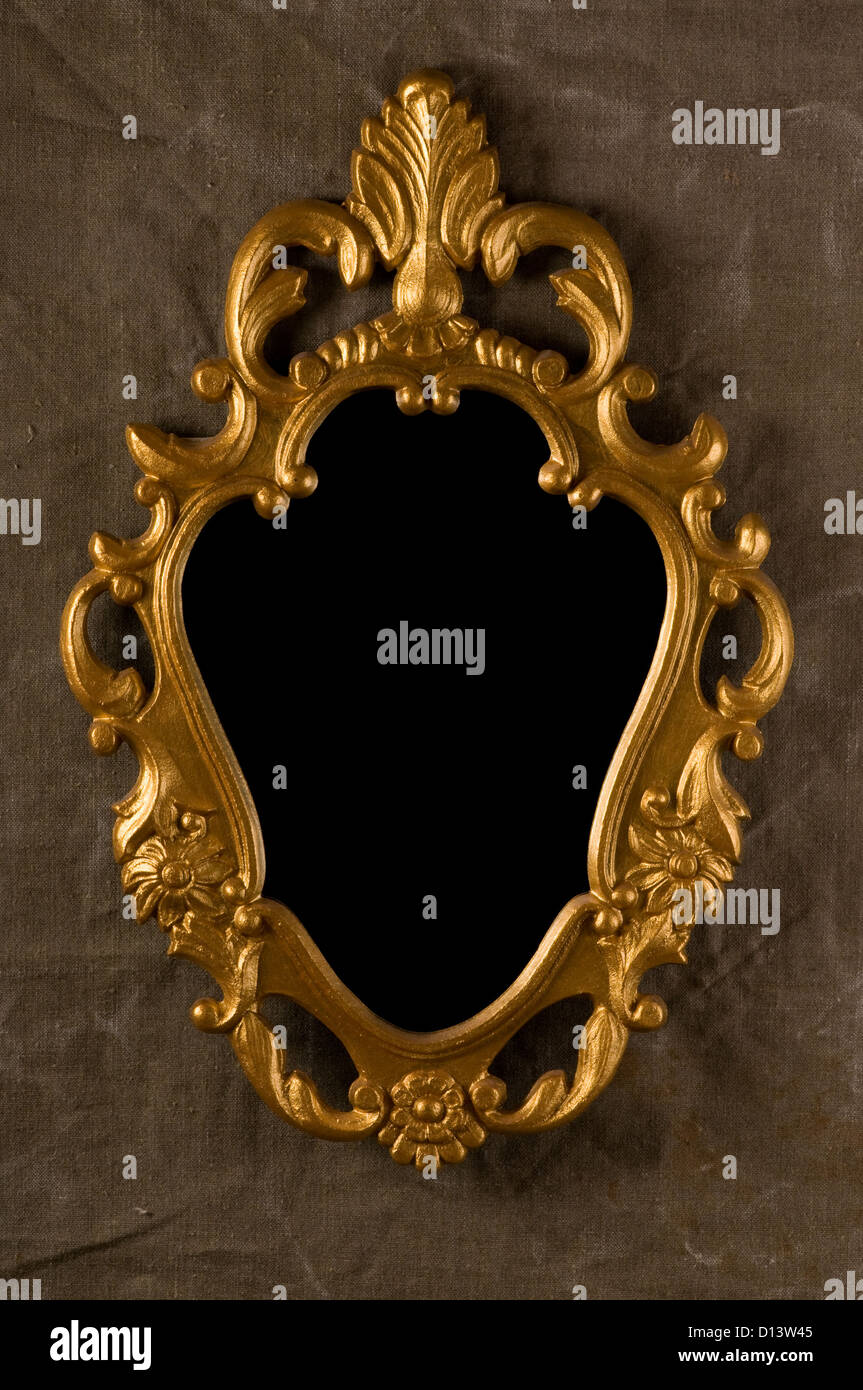 gold vintage frame on fabric wall - Stock Image
