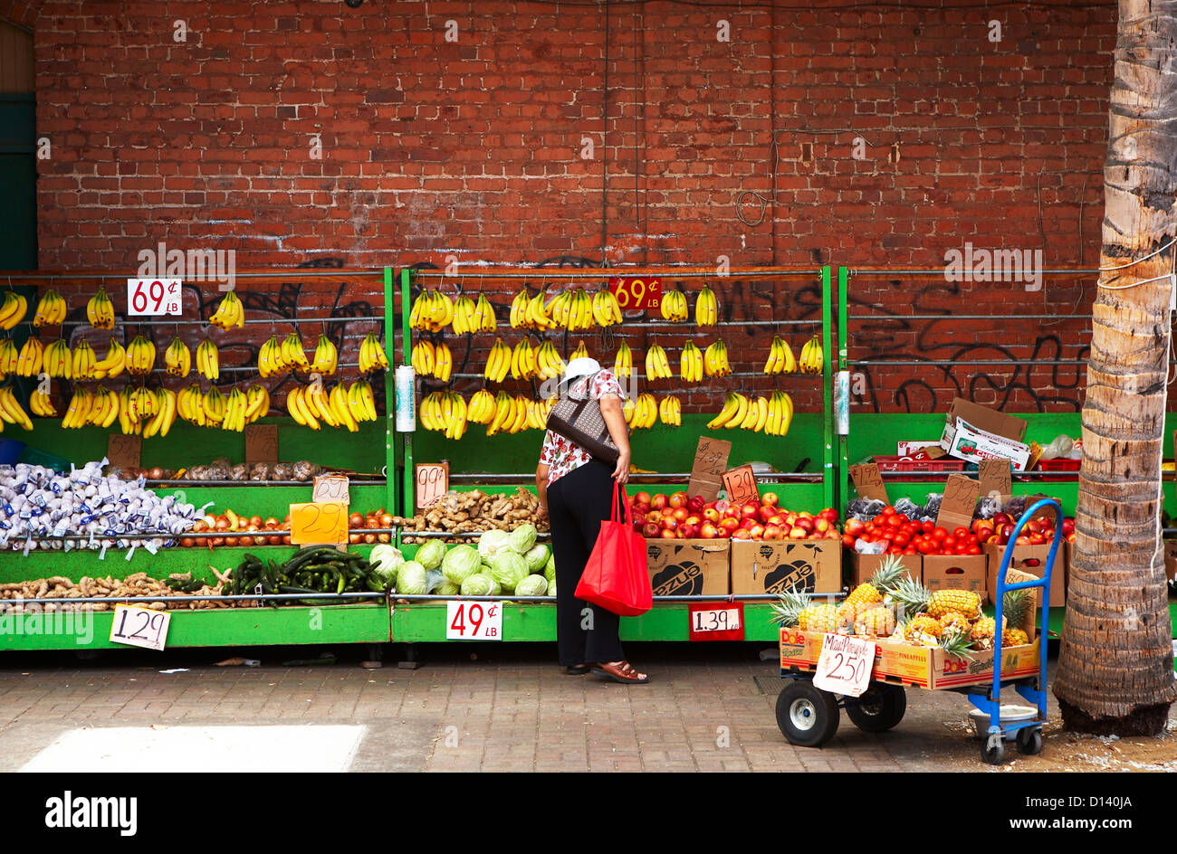 Hawaii, Oahu, Honolulu, Chinatown, Bunches Of Hanging Bananas And Nemour Produce For Sale/N. Stock Photo
