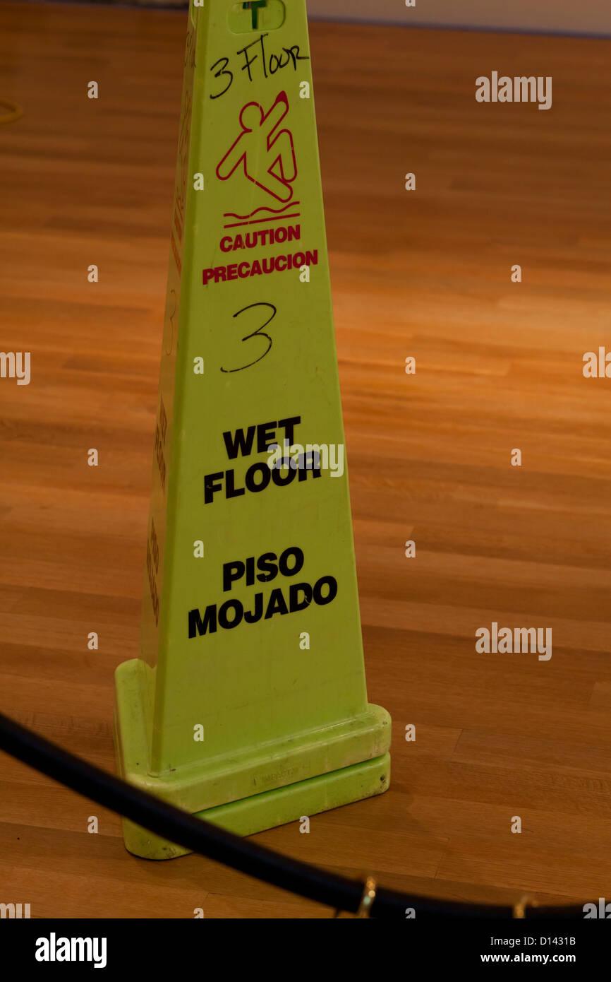 Wet floor cone sign - Stock Image