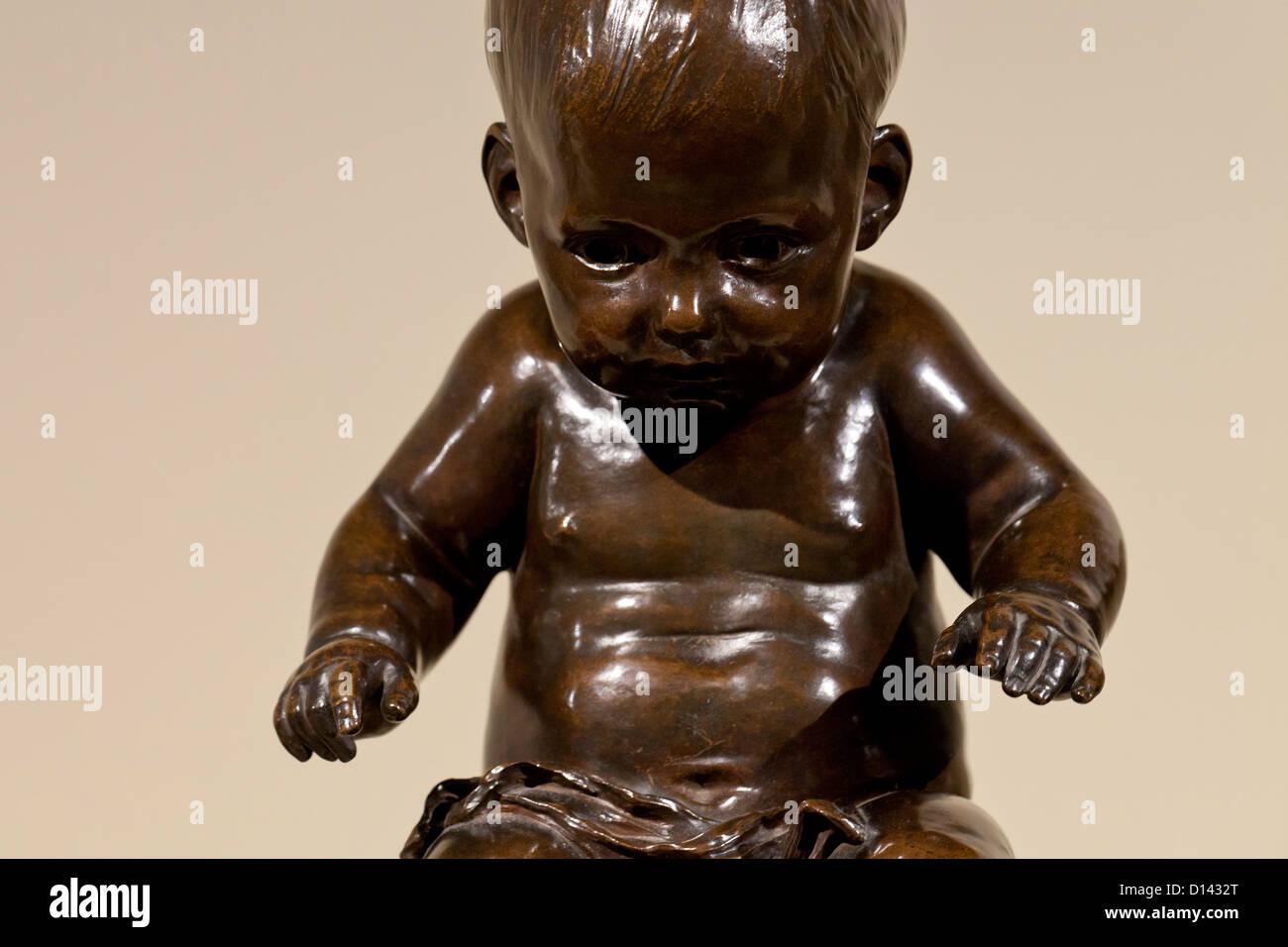 Bronze sculpture of baby boy - Stock Image