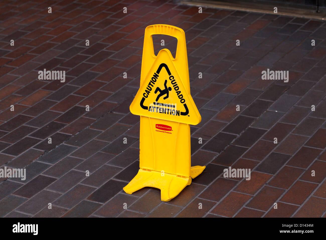 Wet floor sign on tile floor - Stock Image