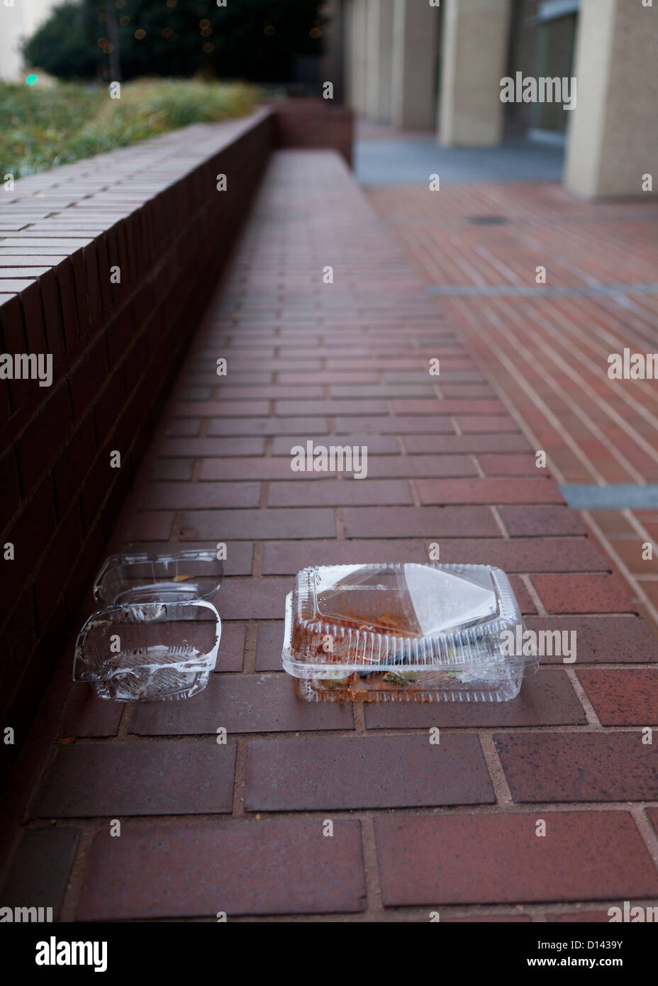 Discarded plastic food containers - Stock Image