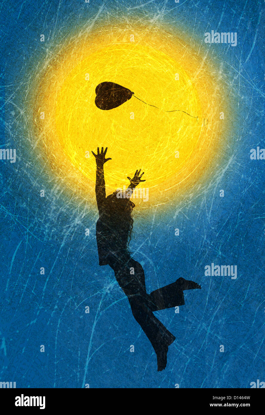 Silhouette of a young girl playing with a heart shape balloon against a textured sun and sky - Stock Image