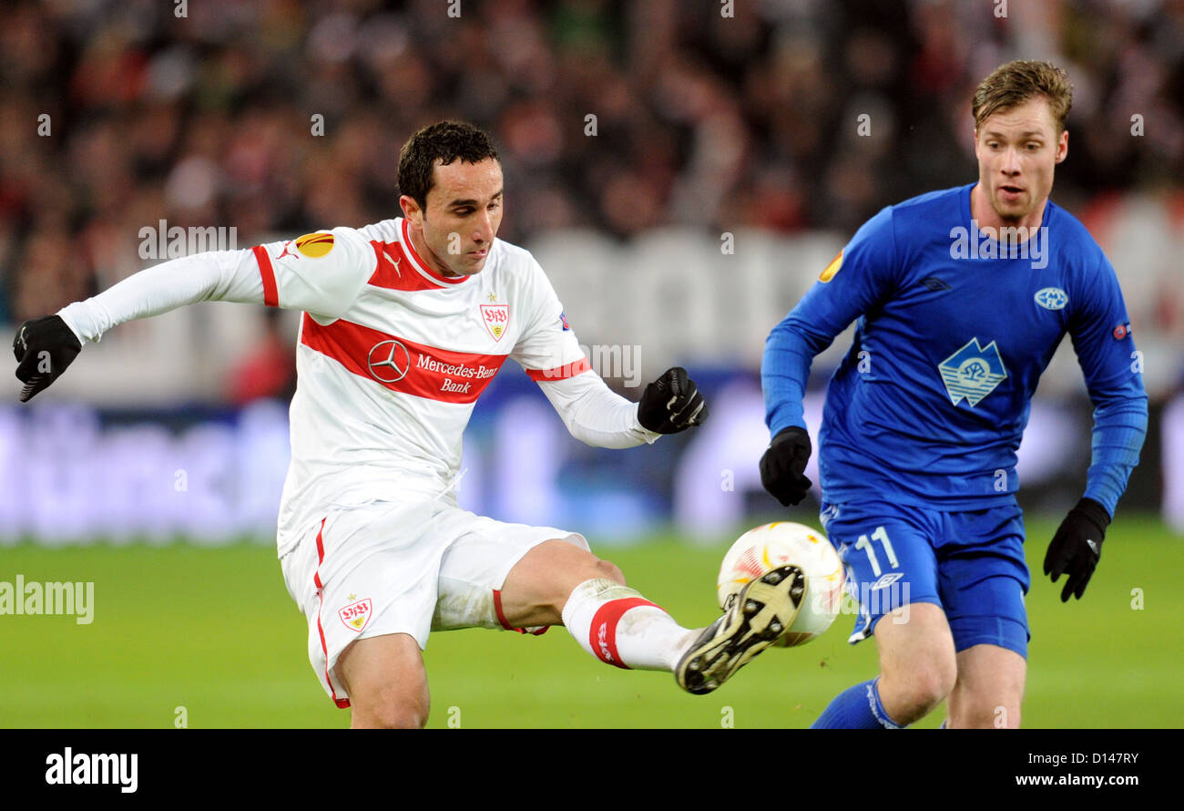 Stuttgarts Cristian Molinaro (L) and Jo Inge Berget (R) of Molde FK vie for the ball during the Europa League group - Stock Image