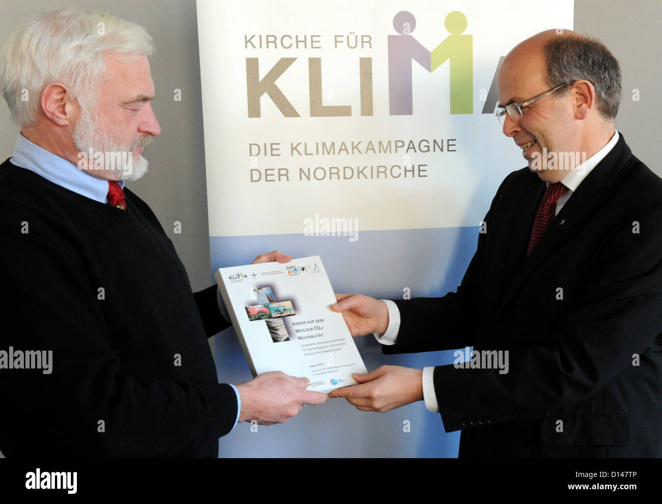 Nobel Prize laureate Olav Hohmeyer (L) from Flensburg University hands over the new climate protection concept of Stock Photo