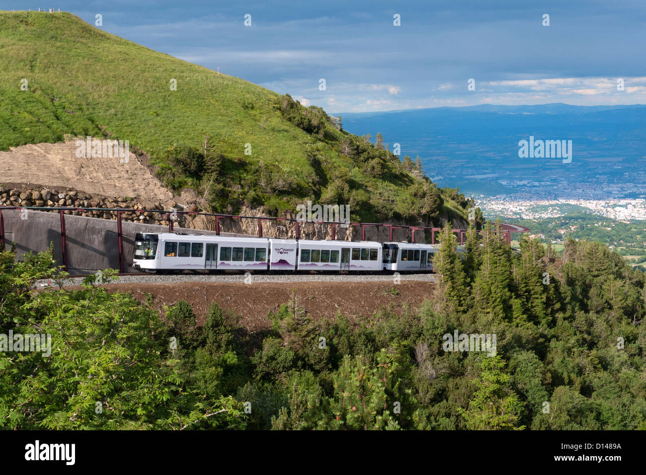 New Panoramique des dome electric cog railway, train arriving at the top of Puy de dome volcano, Auvergne, France - Stock Image