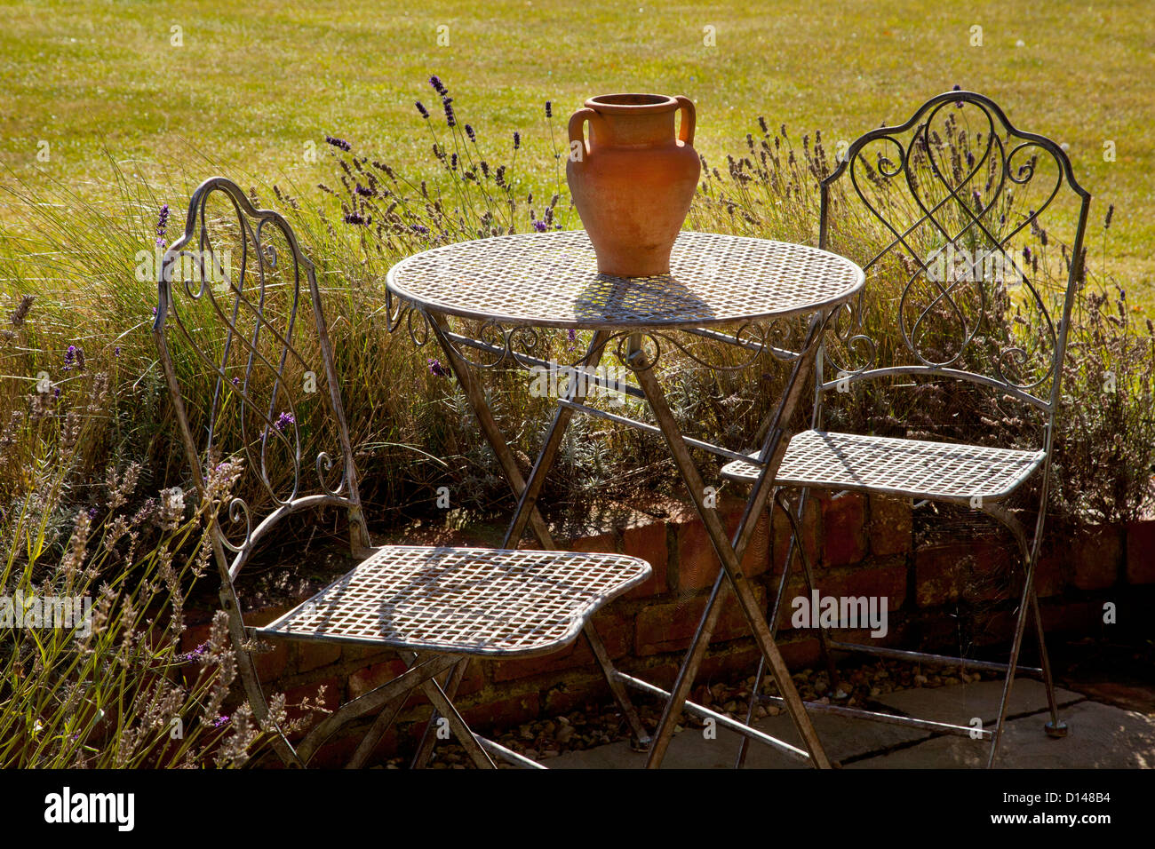 Metal French Style Garden Furniture Table And Chairs With Terracotta Pot In  Summer English Garden