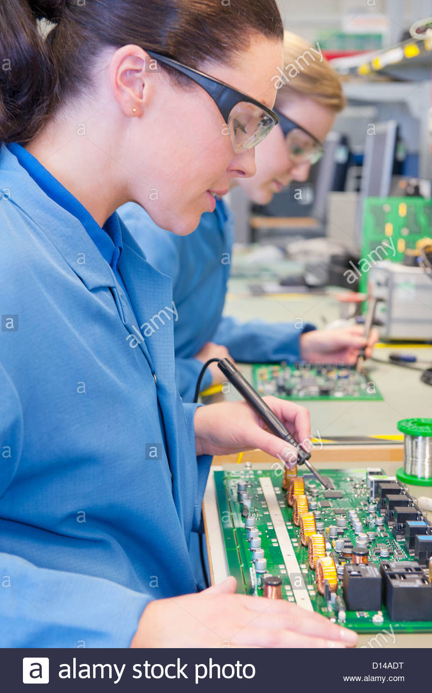 Printed Circuit Boards Stock Photos Boardpcb Mass Production Board Product On Close Up Of Technicians Soldering In Manufacturing Plant Image