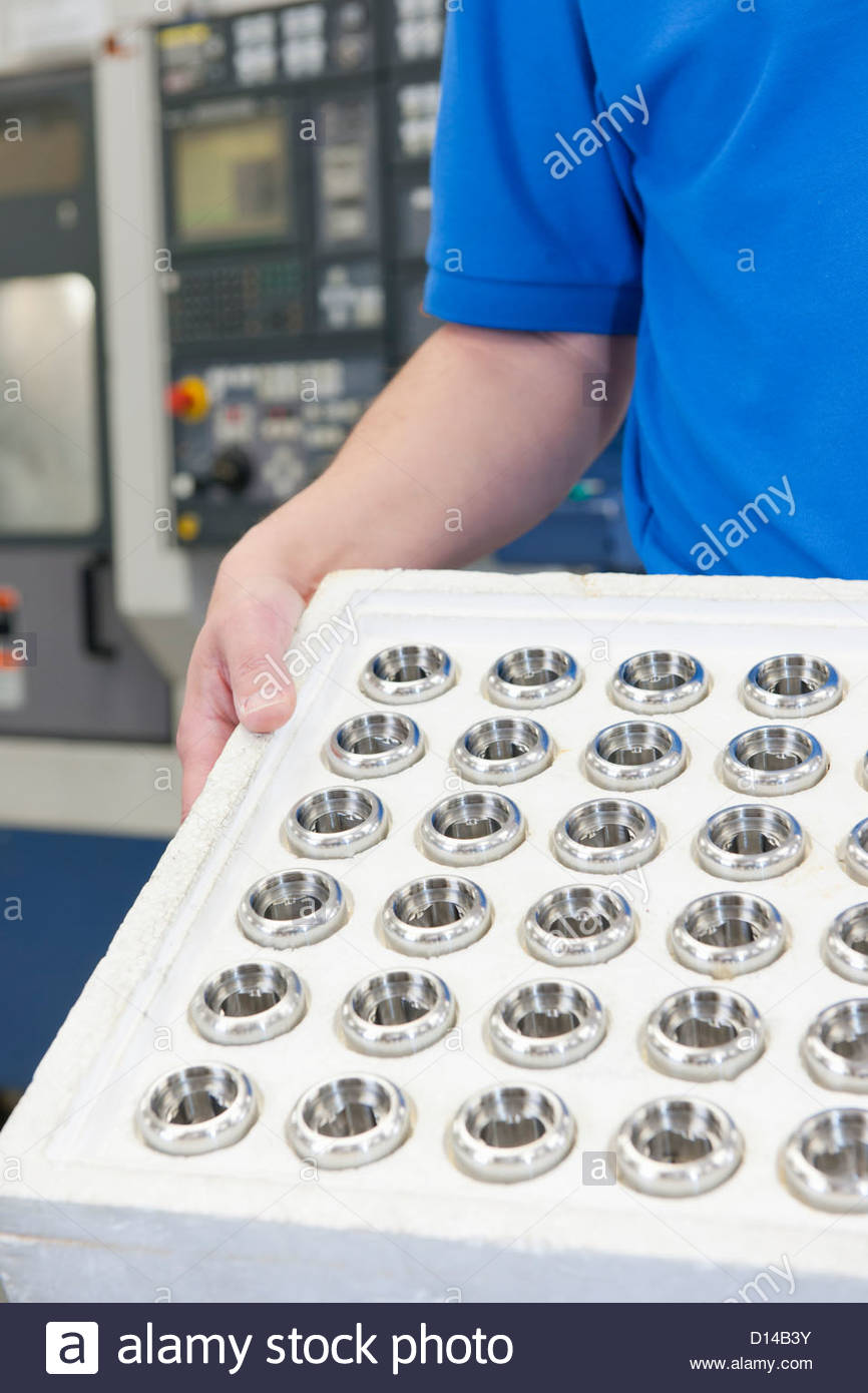 Close up of finished machine parts in manufacturing plant - Stock Image